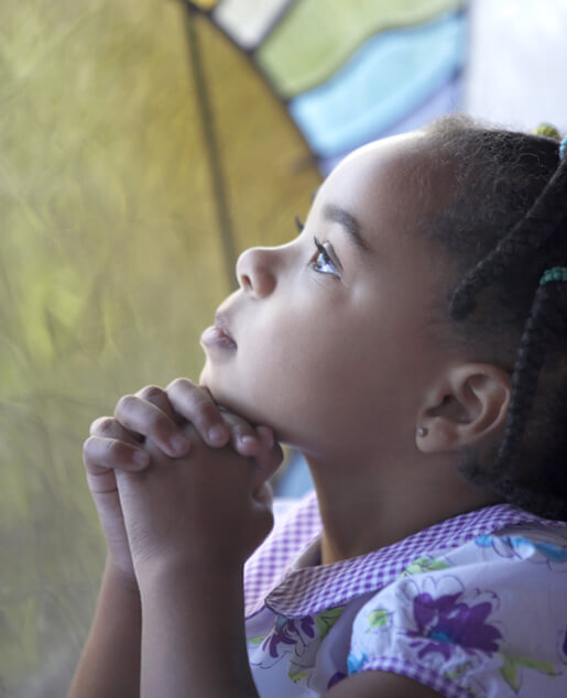Little girl looking up and praying